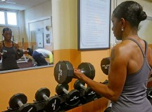 Avril Marlow Featherstone focuses on form during a bicep curl.