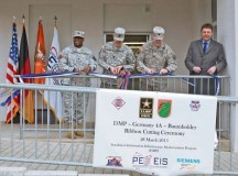 "Lt. Col. Louis L. King, assistant product manager-Europe; Lt. Col. Nathan J. Bollinger, 102nd Signal Battalion commander; Lt. Col. Michael ""Sully"" Sullivan; and Bernhard Sandmaier, Nokia Siemens networks manager, team up for a ribbon cutting to commemorate the official completion of the Installation Information Infrastructure Modernization Program."