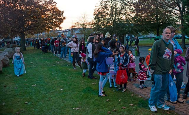 Trick-or-treaters wait in line to receive candy during Trunk-or-Treat.