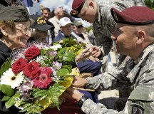 Photo by Staff Sgt. Sara KellerEllan Levitsky-Orkin, a Delaware native who served as a U.S. Army nurse in Normandy during World War II, speaks with a U.S. Army paratrooper during a ceremony to honor their service June 4 in Bolleville, France. The event was one of several commemorations for the 70th anniversary of D-Day operations conducted by Allied forces during World War II June 5 and 6, 1944. More than 650 U.S. military personnel have joined troops from several NATO nations to participate in ceremonies to honor the events at the invitation of the French government.