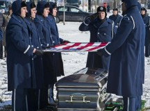 "Photo by Jim VarhegyiPal bearers from the U.S. Air Force Honor Guard fold the flag draped over the the casket of Brig. Gen. Robinson ""Robbie"" Risner during his internment ceremony Jan. 23 at Arlington National Cemetery in Arlington, Va. Risner was the Air Force's 20th ace, and he survived seven and a half years of captivity as a prisoner of war in Hoa Lo Prison during the Vietnam War."