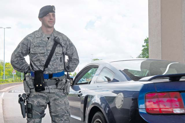 Airman 1st Class Jonathan Ebner, 86th Security Forces Squadro elite gate guard, stands at parade rest after controlling the entry of a vehicle May 23 on Ramstein. Defenders go through a rigorous selection process to be a member of the newly created Elite Gate Guard Section at Ramstein.
