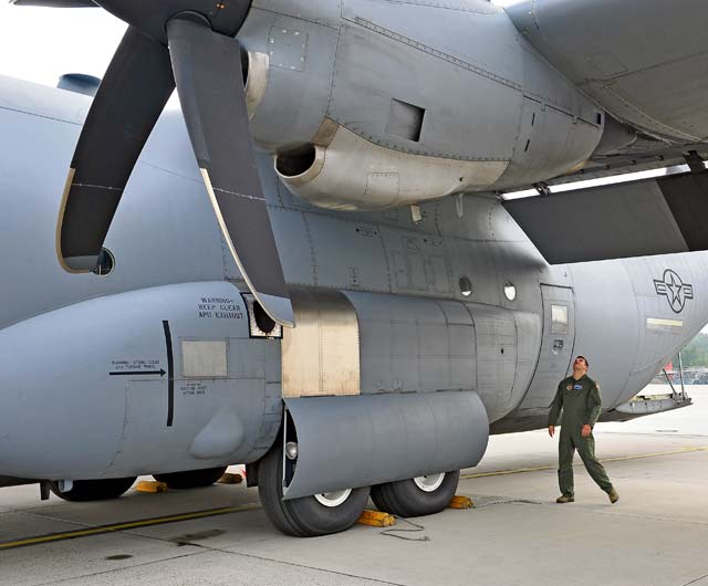 Photo by Airman 1st Class Dymekre AllenWing inspectionCapt. Daniel Sabatelli, 37th Airlift Squadron, inspects the wings of a C-130J Super Hercules June 12 on Ramstein. The 37th AS regularly conducts airlifts, airdrops and aeromedical evacuation operations for the largest air base in Europe.