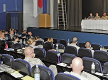 Air Force, Navy and Army NCOs answer questions during the Joint Professional Development Seminar July 18 at Ramstein's Hercules Theater. The seminar was conducted to encourage service members to continue to stay committed to their respective branches of service.