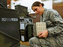 Airman 1st Class Jasmine Luce, 86th Munitions Squadron conventional maintenance crew member, makes sure numbers match up on ammunition cans to prepare for a 100 percent accountability inspection Feb. 13 on Ramstein.