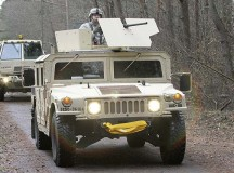 Photo by Sgt. Daniel FriedbergA convoy of 361st Civil Affairs Brigade, 7th Civil Support Command, vehicles moves through the forest Jan. 11 on Rhine Ordnance Barracks.