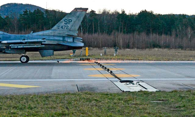 An F-16 Fighting Falcon from Spangdahlem Air Base runs through a test of a Barrier Arresting Kit-12 Jan. 28 on the Ramstein flightline. Safeguarding equipment and the lives of military personnel, the BAK-12 ensures a safe deceleration of landing aircraft within a few seconds.
