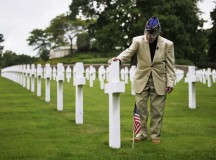 Photo by Senior Airman Hailey HauxWorld War II veteran Leslie Cruise pays his respects to the man who saved his life  Monday at the Lorraine American Cemetery and Memorial in France. Seventy years ago on June 7, 1944, Pvt. Richard Vargas saved Cruise's life during the invasion of Normandy. Cruise went to France five times looking for his friend's grave in order to say thank you.