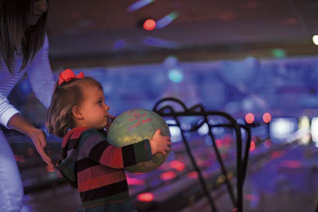 Photo by Airman 1st Class Michael StuartLila, 2, gets ready to roll a bowling ball during a deployed family event Oct. 23 at the Ramstein Bowling Center. The Airman & Family Readiness Center hosts a deployed family event once a month to improve the morale of families of deployed Airmen.