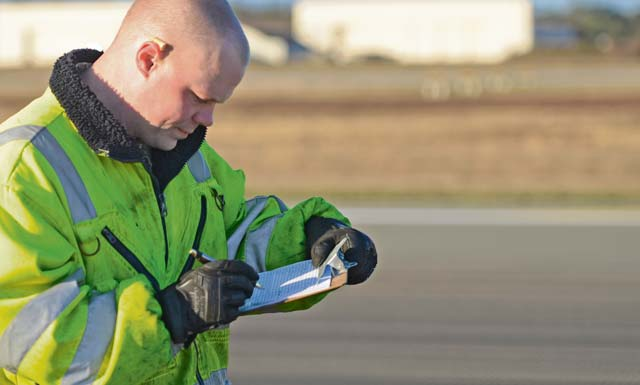 Staff Sgt. Seth Buford, 786th Civil Engineer Squadron power production craftsman, records measurements during a Barrier Arresting Kit-12 test.