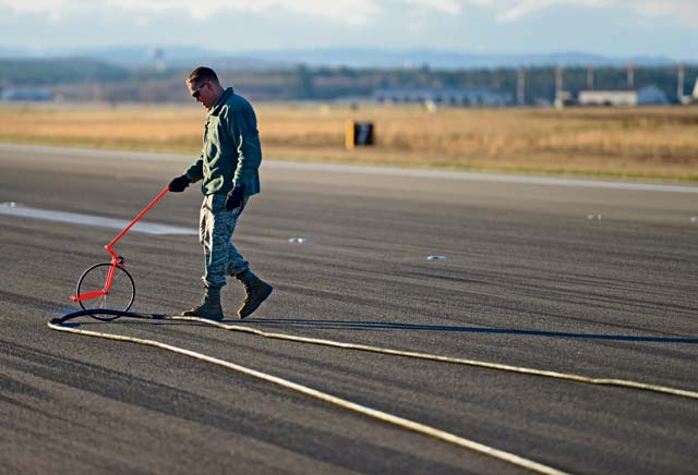 Tech. Sgt. Franklin Furman, 786th Civil Engineer Squadron NCOIC of aircraft arresting systems, measures wires from a Barrier Arresting Kit-12. When all else fails and an aircraft is unable to stop on its own, the BAK-12 decelerates the aircraft on the runway, ensuring the pilot and aircraft land safely.
