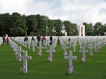 Cub Scouts plant flags during a memorial service at the Luxembourg American Cemetery and Memorial May 26.