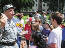 Brig. Gen. Paul Benanati, deputy commanding general for the 21st Theater Sustainment Command, talks with school children about Meals Ready to Eat during a German-American partnership event June 10 on Panzer Kaserne.