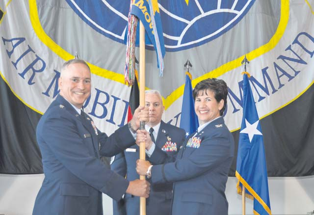 "Photo by 2nd Lt. Henry LancasterCol. Nancy Bozzer assumes command of the 521st Air Mobility Operations Wing June 18 on Ramstein. The ceremony was officiated by Maj. Gen. Frederick ""Rick"" Martin, U.S. Air Force Expeditionary Center commander."