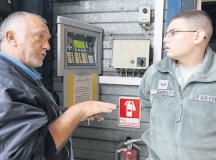 Guenter Spletter explains the wash rack operating controls to Senior Airman Matthew Jensen, both 86th Vehicle Readiness Squadron vehicle operators, Sept. 12 on Ramstein. The wash rack services approximately 1,800 government motor vehicles in the KMC.