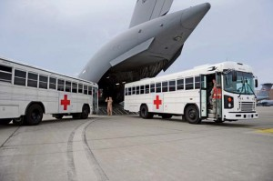 Two buses from the Contingency Aeromedical Staging Facility prepare to leave the flightline after transporting patients to a C-17 Globemaster III Oct. 10 on Ramstein. On average, the CASF supports approximately 250 to 300 patients a month.