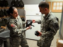 Romero disassembles an M40/A1 protective mask with Staff Sgt. Jose Espinoza, a platoon sergeant and armorer also with HHC, Feb. 26 on Daenner Kaserne.