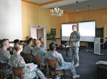 Col. Darren Werner, commander of 16th Sustainment Brigade, 21st Theater Sustainment Command, leads a discussion about team building during a command team training event held at the Rheinlander Club Sept 6.