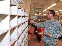 Sgt. Victor Rincon, postal NCO assigned to the 35th Infantry Division, distributes mail Jan. 29 at the Mail Distribution Node on Panzer Kaserne in Kaiserslautern. Rincon and nine other Soldiers from across the Army received postal operations training from the 21st Theater Sustainment Command and U.S. Army Garrison Rheinland-Pfalz Jan. 13 through 30.