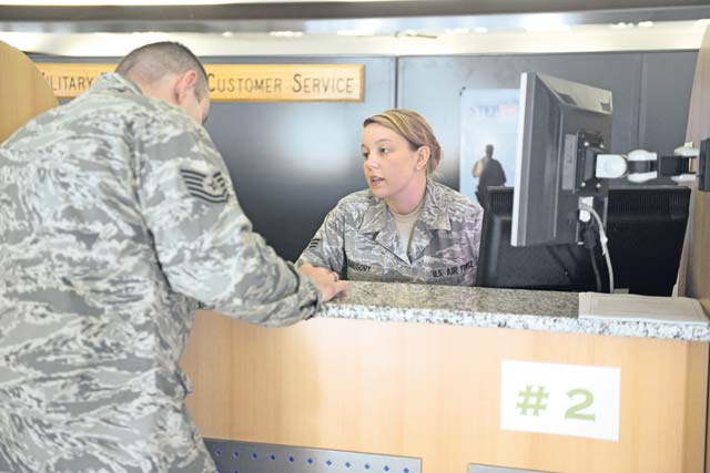 Photo by Tech. Sgt. James HodgmanSenior Airman Victoria Gregory, 86th Comptroller Squadron relocation pay  technician, assists a customer with a financial discrepancy. Airmen from the 86th CPTS are professional advisers funding the fight to meet the demanding customer service needs of the 57,000 members of the KMC.