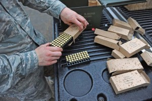 "An 86th Security Forces Squadron member prepares trainer bullets for trainees during ""Shoot, Move, Communicate"" training."