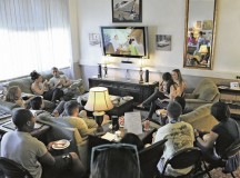 Airmen watch a movie and enjoy a home-cooked meal in the living room of Club 7. Club 7 is the place to go to build a healthy community amongst single Airmen living in the dorms.