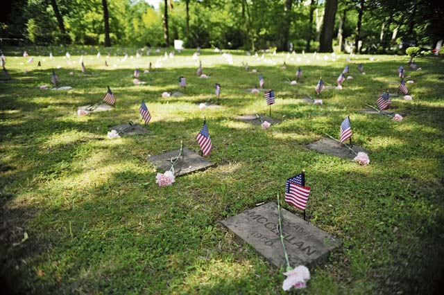 The Kindergraves are the final resting places for 451 American children of service members stationed in Europe during the buildup of the Cold War. The graves were decorated with American flags and roses before the ceremony.