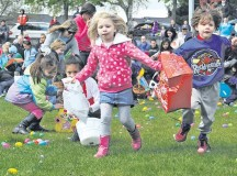 Children stampede the field as they grab as many eggs as possible during the Ramstein Easter Egg Hunt and Kite Karnival. A few golden Easter eggs were scattered amongst the eggs, and prizes were given to the children who found them.