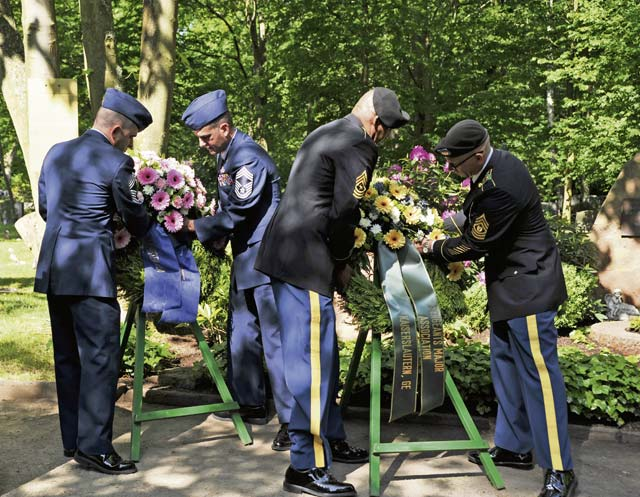 Air Force and Army personnel present wreaths in honor of their respective branches during the annual Kindergraves ceremony at the Kaiserslautern cemetery.