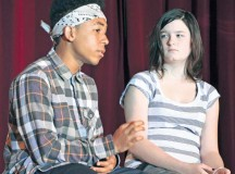 "Photo by Elizabeth Behring""Chuck,"" played by Daniel Estrada, tries to convince ""Michelle,"" played by Caitlin Akers, that an easy way to deal with difficult problems – instead of working them out by talking or other healthy ways – is to take drugs. The eighth-graders performed the play ""Choices"" Oct. 25 at Kaiserslautern Middle School on Vogelweh. The show, directed by drama, business and study skills teacher Iris Abbott and assisted by Adolescent Substance Abuse counselor Nick Seri, was the final event for the school's anti-drug ""Spirit Week,"" which supported the Army's Red Ribbon Week."