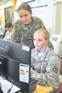 U.S. Army Pfc. Karlea E. Henderson (right), a human resources specialist assigned to the 21st Theater Sustainment Command's 18th Engineer Brigade acting as a personnel clerk for the simulated 70th Infantry Division higher command, and Croatian army Maj. Ruzica Pavic Kevric, a medical practitioner specializing in occupational and sports medicine at the Croatian Institute for Aviation Medicine, the simulated 70 ID medical officer, review a casualty report during the Operation Immediate Response 13 training exercise Aug. 26.