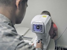 Senior Airman Lloydon Balili, 86th Aerospace Medicine Squadron ophthalmic technician, uses an auto-refractor to determine a patient's baseline prescription Sept. 30 on Ramstein. As U.S. Air Forces in Europe's largest optometry clinic, they treat ID cardholders for anything from retraining physicals to school screenings.