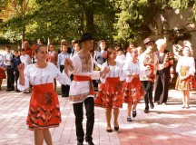 Students from School 12 perform a traditional Moldovan dance during the ribbon cutting for the newly renovated school in Chisinau, Moldova. The students performed the dance as a show of gratitude to the 435th Air Ground Operations Wing's Construction and Training Squadron, which sent Airmen to perform renovations on four restrooms, two locker rooms and two shower rooms in the school to make them functional and safe to use again.