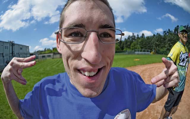 Ramstein High School softball player Josh Davis gets his photo taken while waiting on third base during an adaptive softball game on Ramstein.