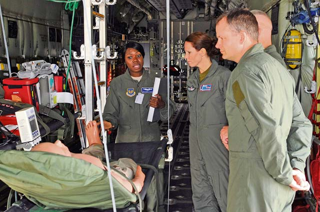 Staff Sgt. Ieshia Pledger, 86th Aeromedical Evacuation Squadron AE specialist, explains the equipment and procedures for AE missions to  members of the Norwegian medical branch during a tour Oct. 3 on Ramstein. The medical branch visited the Contingency Aeromedical Staging Facility, Landstuhl Regional Medical Center and other medical agencies to learn how the U.S. performs aeromedical evacuation and critical care aeromedical transport missions.