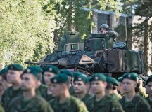 A U.S. Army M2A3 Bradley Fighting Vehicle rolls past Lithuania military members in the Saber Strike kick-off ceremony June 9 at the Adazi  training area in Latvia. Saber Strike is a long-standing, multilateral security cooperation exercise conducted at locations throughout the Baltic region.
