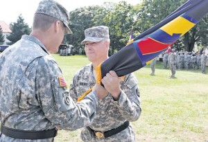 Brig. Gen. Arlan M. DeBlieck, incoming commanding general, 7th Civil Support Command, receives the unit colors from Maj. Gen. John R. O'Connor, commanding general of the 21st Theater Sustainment Command, during a change of command ceremony Saturday. DeBlieck took responsibility of command from Brig. Gen. Paul M. Benenati, outgoing commanding general, 7th Civil Support Command after 20 months in command.