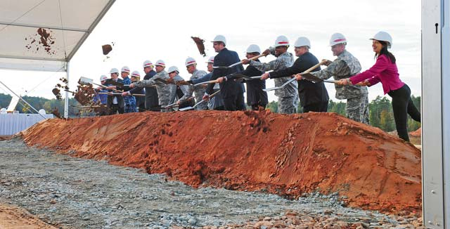 Photo by Sgt. Daniel ColeSenior U.S. military leaders, German dignitaries and former wounded U.S. service members turn the first shovels of earth Oct. 24 to mark the start of construction of the Rhine Ordnance Barracks Medical Center that will replace Landstuhl Regional Medical Center and the Ramstein Air Base Clinic.