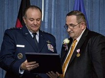 Photo by Senior Airman Jonathan StefankoGen. Philip M. Breedlove, commander of U.S. European Command and Supreme Allied Commander Europe, and John Mace read a certificate of service during Mace's retirement ceremony Dec. 12 on Ramstein. Mace retired from the military after 25 years and retired again from civil service after 29 years.