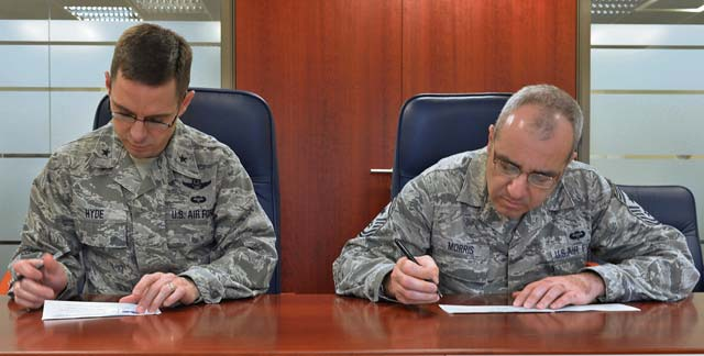 Photo by Airman 1st Class Holly Cook Brig. Gen. C. K. Hyde, 86th Airlift Wing commander, and Chief Master Sgt. James Morris, 86th AW command chief, fill out an  Air Force Assistance Fund form April 3 on Ramstein. The AFAF was established to provide assistance through donations to  organizations charged with helping Airmen and their families.