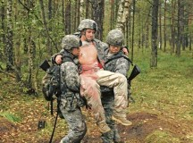 Photo by Sgt. 1st Class Randall JacksonFirst Lt. Jorge Delgado (left), assigned to the 212th Combat Support Hospital, evacuates a casualty with the help of a support Soldier during the Expert Field Medical Badge test Sept. 13. The EFMB test is the utmost challenge to the professional competence and physical endurance of the military medical professional.