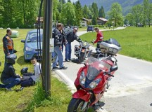 Courtesy photoDuring a motorcycle ride in the Garmisch area of Germany, husband-wife team Sgts. 1st Class Cathleen Stadler-Frazier and Robert Frazier render aid to an accident victim who was thrown from his motorcycle during an organized bike ride. Cathleen provided medical assistance to the victim while Robert ensured the accident scene was safe and secure.