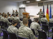 Airman 1st Class Christopher Torres, 86th Aircraft Maintenance Squadron dedicated crew chief, delivers a speech to shopmates after releasing a C-130J Super Hercules with a black letter designation Oct. 7 on Ramstein. A black letter designation indicates that an aircraft is operating under ideal circumstances and has no outstanding mechanical issues or due inspections.