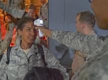 Maj. Mayra Zapata, 633rd Medical Operations Squadron, gets her temperature taken by Tech. Sgt. Saquadrea Crosby, 86th Aerospace Medicine Squadron public health NCOIC, as she deplanes a C-130J Super Hercules Oct. 19 on Ramstein. Any personnel traveling into Ramstein from Ebola infected areas will be medically screened upon their arrival and cleared by public health for onward travel to ensure the health and safety of all passengers, aircrew and members of the KMC.
