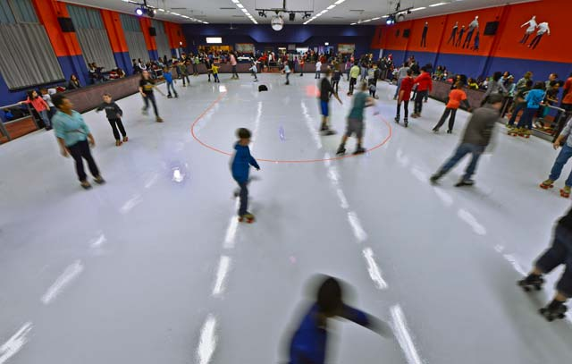 Skaters enjoy the newly opened Cross Roads Community Center for the first time Nov. 1 on Vogelweh. The Crossroads Community Center offers the KMC a new way to spend time with family and friends of all ages.