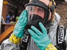 Airman 1st Class Eric Welsh, 786th Civil Engineer Squadron emergency management journeyman, dons an oxygen mask while preparing for a biological response exercise  Sept. 26 on Ramstein. Squadrons train quarterly to stay prepared for real-world situations.