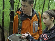 Staff Sgt. Joshua Krape, 86th Operational Support Squadron survive, evade, resist and escape specialist, ensures Maddie Morelock, daughter of Air Force Col. Michael Morelock and Advancement Via Individual Determination student, finds her mark during the NAVid Challenge May 23 in Landstuhl.