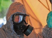 A Soldier assigned to the 7th Civil Support Command's 773rd Civil Support Team decontaminates after entering a simulated contamination area during a joint training exercise Sept. 25 on Panzer Kaserne.