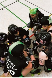 Members of the Roller Girls of the Apocalypse roller derby team talk to each other about different strategies during a bout March 9 in Kaiserslautern. The team, originally the K-Town Derby Girls, is a nonprofit sports club for anyone looking for a little recreation.