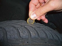 To check your tires' tread depth, stick a euro coin into the tread. If the golden edge remains visible, your tire is worn down and it's time to purchase a new tire.